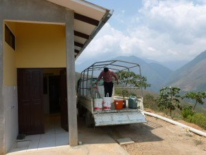 Felix unloading raw honey produced by local farmers at the FUNDACOM processing plant. Photo credit: Rachel Satterlee.