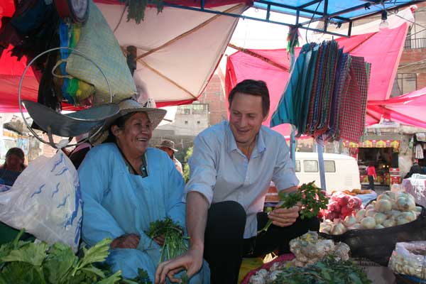 Claus Meyer at a market in Bolivia. [Photo Credit: Christina Smedegaard Jensen, taken from the Danida Fellowship Centre]